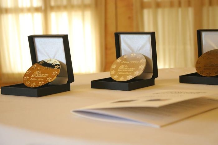 Médailles et livret de la cérémonie de remise des prix de l'édition 2019 du Concours du Lobbying
